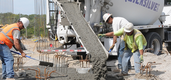 Men pouring concrete